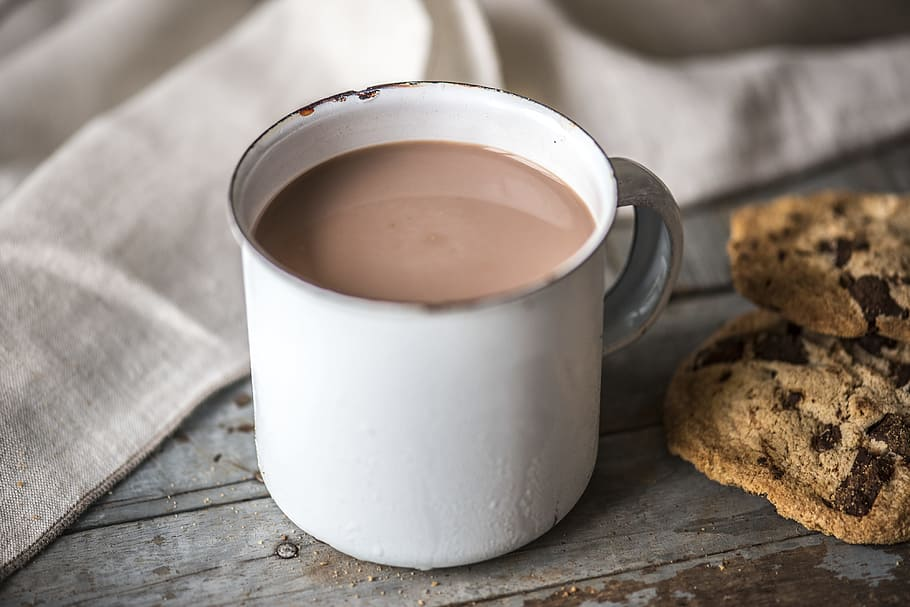 cup of masala chai tea and biscuits